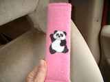 Panda seat belt wrap on pink fleece